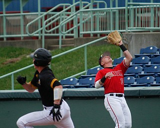 YSU's Drew Dickerson catches a fly ball hit by NKU's Collin Hohman during their game at Eastwood Field on Friday. EMILY MATTHEWS   THE VINDICATOR