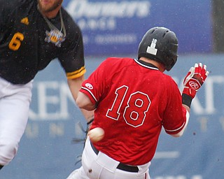 YSU's Drew Dickerson slides safely into second as NKU's Collin Luty misses the throw from home during their game against NKU at Eastwood Field on Friday. EMILY MATTHEWS   THE VINDICATOR