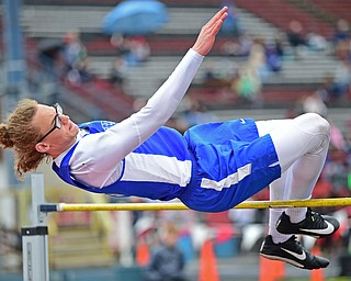 AUSTINTOWN, OHIO - APRIL 20, 2019: Western Reserve's Luke Kilbert clears the bar during the boys high jump during the Mahoning County Track & Field Championship Meet at Austintown Fitch High School. DAVID DERMER | THE VINDICATOR
