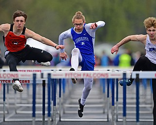 AUSTINTOWN, OHIO - APRIL 20, 2019: (LtoR) Springfield's Beau Brungard, Western Reserve's Luke Kilbert and Jackson Milton's Ryan Staton clear hurdles during the boys 110 meter hurdles during the Mahoning County Track & Field Championship Meet at Austintown Fitch High School. DAVID DERMER | THE VINDICATOR
