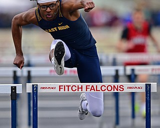 AUSTINTOWN, OHIO - APRIL 20, 2019: East's Tobias Hayes clears a hurdle during the boys 110 meter hurdles during the Mahoning County Track & Field Championship Meet at Austintown Fitch High School. DAVID DERMER | THE VINDICATOR