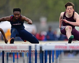 AUSTINTOWN, OHIO - APRIL 20, 2019: Boardman's Brian Yauger, right, and Fitch's Reggie Floyd clear hurdles during the boys 110 meter hurdles during the Mahoning County Track & Field Championship Meet at Austintown Fitch High School. DAVID DERMER | THE VINDICATOR