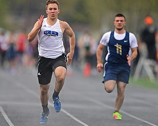 AUSTINTOWN, OHIO - APRIL 20, 2019: Jackson Milton's Sean Lengyel runs to the finish line ahead of Lowellville's Vinny Layko during the boys 100 meter dash during the Mahoning County Track & Field Championship Meet at Austintown Fitch High School. DAVID DERMER | THE VINDICATOR
