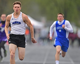 AUSTINTOWN, OHIO - APRIL 20, 2019: Jackson Milton's Dylan Gibbs runs to the finish line ahead of Western Reserve's Russell Adair during the boys 100 meter dash during the Mahoning County Track & Field Championship Meet at Austintown Fitch High School. DAVID DERMER | THE VINDICATOR