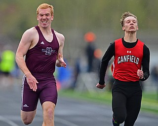 AUSTINTOWN, OHIO - APRIL 20, 2019: Boardman's Zach Hillard and Canfield's David Schmidt run to the finish line during the boys 100 meter dash during the Mahoning County Track & Field Championship Meet at Austintown Fitch High School. DAVID DERMER | THE VINDICATOR