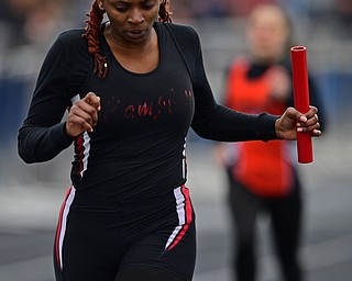 AUSTINTOWN, OHIO - APRIL 20, 2019: Campbell's Kaleecia Addison crosses the finish line to win the girls 4x200 meter relay during the Mahoning County Track & Field Championship Meet at Austintown Fitch High School. DAVID DERMER | THE VINDICATOR