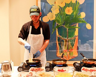 Zeke Pedrick, with Kravitz Deli, prepares omelettes at the annual Easter Brunch at Fellows Riverside Gardens on Sunday. EMILY MATTHEWS | THE VINDICATOR