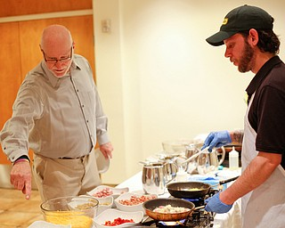 Zeke Pedrick, right, with Kravitz Deli, prepares an omelette for Ed Medved, of Warren, at the annual Easter Brunch at Fellows Riverside Gardens on Sunday. EMILY MATTHEWS | THE VINDICATOR