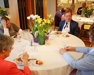 Clockwise from top left, Becky Neuman, Doug Neuman, Billie Neuman, and Jane Porter, all of Niles, eat at the annual Easter Brunch at Fellows Riverside Gardens on Sunday. EMILY MATTHEWS | THE VINDICATOR