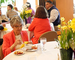 Jane Porter, of Niles, eats at the annual Easter Brunch at Fellows Riverside Gardens on Sunday. Her daughter, Billie Neuman, said this is Porter's 95th Easter. EMILY MATTHEWS | THE VINDICATOR