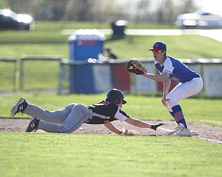 Western Reserve first basemen Dan Windham (3) waits on a throw to first as Springfield's John Slike (5) slides back safely  during Monday afternoons game at Springfield High School.  Dustin Livesay  |  The Vindicator  4/22/19  Springfield Local