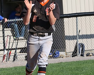 Jarret Orbin (8) of Springfield claps his hands as he crosses home plate during Monday afternoons game against Western reserve at Springfield High School.  Dustin Livesay  |  The Vindicator  4/22/19  Springfield Local