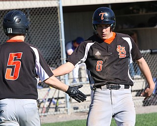 Springfield's Jarret Orbin (8) celebrates with teammate John Slike (5) after scoring the the first run of the game  during Monday afternoons game against Western Reserve at Springfield High School.  Dustin Livesay  |  The Vindicator  4/22/19  Springfield Local