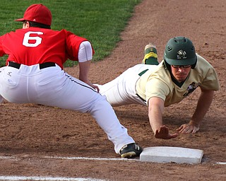 William D. Lewis The VindicatorvUrsuline's Jake Freisen dives back to first as Girard;s Nick DeGregory(6) waits for the throw during 4-24-19 game  at Cene.