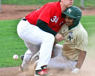 William D. Lewis The Vindicator  Girard 3rd baseman Matt Miles(34) loses control of the ball as Ursuline's Dante Walker(27) is safe at 3rd during 4-24-19 game  at Cene.