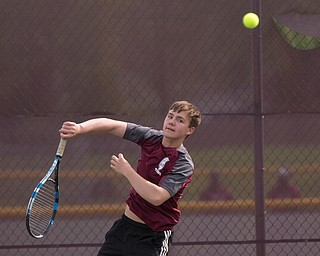 Boardman's Justin Olsen hits the ball back to Ursuline's Greg Morgione during their match at Boardman on Wednesday. EMILY MATTHEWS | THE VINDICATOR