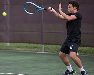 Ursuline's Greg Morgione hits the ball back to Boardman's Justin Olsen during their match at Boardman on Wednesday. EMILY MATTHEWS | THE VINDICATOR