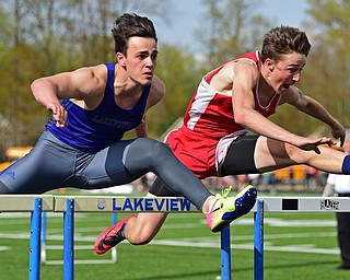 Badger's Brandon Greathouse, right, and Lakeview's Liam Boivin compete during the boys 110 meter hurdles, Thursday afternoon during the Trumbull County Track Meet at Lakeview High School.