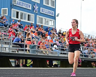 CORTLAND, OHIO - MAY 2, 2019: Girard's Nicole Chalker runs to the finish line to win her heat of the girl 1600 meter run, Thursday afternoon during the Trumbull County Track Meet at Lakeview High School. DAVID DERMER | THE VINDICATOR