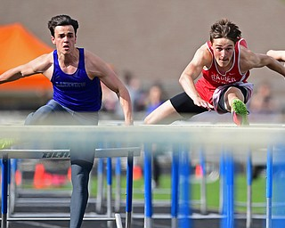 CORTLAND, OHIO - MAY 2, 2019: Badger's Brandon Greathouse, right, and Lakeview's Liam Boivin compete during the boys 110 meter hurdles, Thursday afternoon during the Trumbull County Track Meet at Lakeview High School. DAVID DERMER | THE VINDICATOR