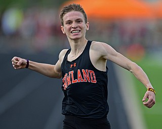 CORTLAND, OHIO - MAY 2, 2019: Howland's Vincent Mauri celebrates while crossing the finish line to win his heat of the boys 1600 meter run, Thursday afternoon during the Trumbull County Track Meet at Lakeview High School. DAVID DERMER | THE VINDICATOR