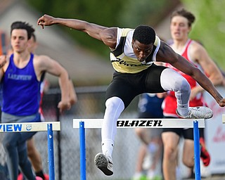 CORTLAND, OHIO - MAY 2, 2019: Harding's JeSean Sledge competes during the boys 300 meter hurdles, Thursday afternoon during the Trumbull County Track Meet at Lakeview High School. DAVID DERMER | THE VINDICATOR