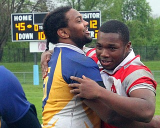 William D. Lewis The Vindicator  East's Turhan Henderson(5) and Chaney'sTerrance Love hug afterEast defeated Chaney 45-12 at Rayen Stadium 5-3-19.