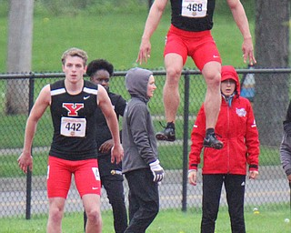 William D. Lewis The Vindicator YSU's Chad Zallow jumps high while warming up for 100 . at left is Brendan Lucas.