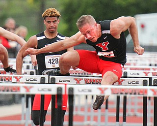 William D. Lewis The vindicator YSU's Chad Zallow,right , and Jonathan Blackmon compete in 110 high hurdles.