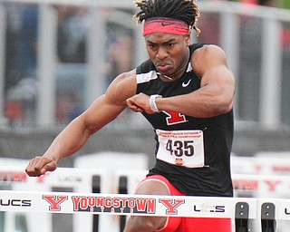 William D. Lewis The Vindicator YSU's Collin Harden competes in 110 high hurdles