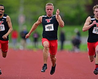 YOUNGSTOWN, OHIO - MAY 5, 2019: Youngstown State's Chad Zallow sprints ahead of Josh Beaumont, left, and Brendan Lucas, right, during the Men's 100 meter, Sunday afternoon during the Horizon League Outdoor Track Championship at the Youngstown State Sports Complex. DAVID DERMER | THE VINDICATOR