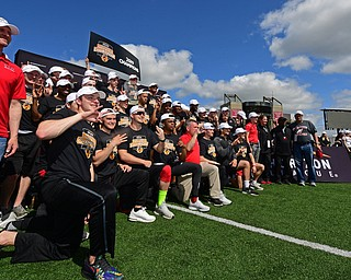 YOUNGSTOWN, OHIO - MAY 5, 2019: Members of the Youngstown State men's track team celebrate after winning the 2019 Horizon League Outdoor Track Championship, Sunday afternoon at the Youngstown State Sports Complex. DAVID DERMER | THE VINDICATOR