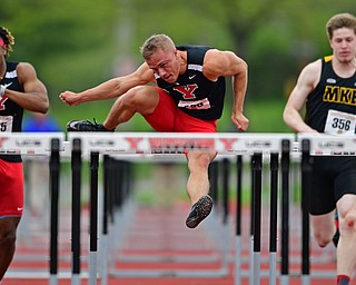 YOUNGSTOWN, OHIO - MAY 5, 2019: Youngstown State's Chad Zallow clears a hurdle while racing Collin Harden, left, and Milwaukee's Sam Conger during the Men's 110 meter hurdles, Sunday afternoon during the Horizon League Outdoor Track Championship at the Youngstown State Sports Complex. DAVID DERMER | THE VINDICATOR