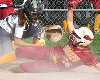 William D. Lewis The Vindictor  Mooney's Conchetta Rinaldi(26) scores during 7th inning as Fitch catcher Kayla Kelty(1) fails to make the tag. Mooney won 8-3 at Fitch 5-6-19..
