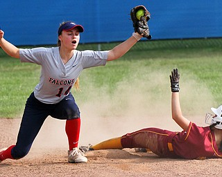 William D. Lewis The Vindictor Fitch's Elyssa Molody (14) reacts after tagging Mooney's Lexi Diaz(11). Mooney won 8-3 at Fitch 5-6-19..