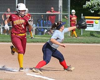 William D. Lewis The Vindictor  Mooney'sAlaina Francis(5) is safe at 1rst as Fitch's Maddy Taylor waits for the throw .Mooney won 8-3 at Fitch 5-6-19.