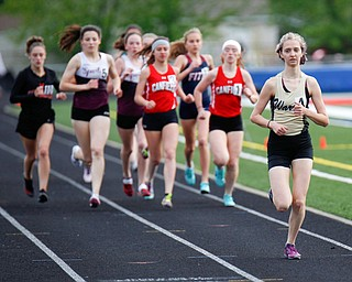 Warren G. Harding's Audrey Masters leads the pack during the first lap of the Girls 1600 Meter Run at the All-American Conference Red Tier High School Track Championships at Austintown Fitch Greenwood Chevrolet Falcon Stadium on Tuesday. EMILY MATTHEWS | THE VINDICATOR