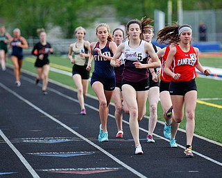 Boardman's Raegan Burkey, left, and Canfield's Ashley Ventimiglia push for the lead during the Girls 1600 Meter Run at the All-American Conference Red Tier High School Track Championships at Austintown Fitch Greenwood Chevrolet Falcon Stadium on Tuesday. EMILY MATTHEWS | THE VINDICATOR
