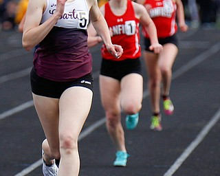 Boardman's Raegan Burkey finished in the lead for the Girls 1600 Meter Run at the All-American Conference Red Tier High School Track Championships at Austintown Fitch Greenwood Chevrolet Falcon Stadium on Tuesday. EMILY MATTHEWS | THE VINDICATOR
