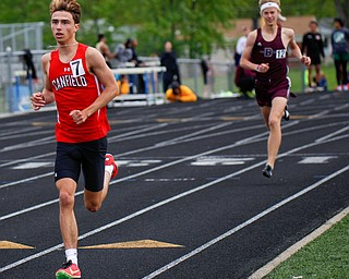 Canfield's Giovanni Copploe keeps his lead with Boardman's Mitchel Dunham behind him during the Boys 1600 Meter Run at the All-American Conference Red Tier High School Track Championships at Austintown Fitch Greenwood Chevrolet Falcon Stadium on Tuesday. EMILY MATTHEWS | THE VINDICATOR