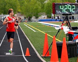 Canfield's Giovanni Copploe finishes in first for the Boys 1600 Meter Run at the All-American Conference Red Tier High School Track Championships at Austintown Fitch Greenwood Chevrolet Falcon Stadium on Tuesday. EMILY MATTHEWS | THE VINDICATOR