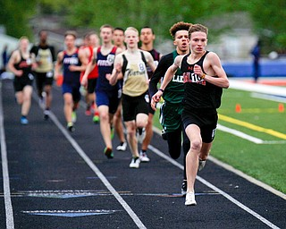 Howland's Vincent Mauri leads the pack during the Boys 800 Meter Run at the All-American Conference Red Tier High School Track Championships at Austintown Fitch Greenwood Chevrolet Falcon Stadium on Tuesday. EMILY MATTHEWS | THE VINDICATOR