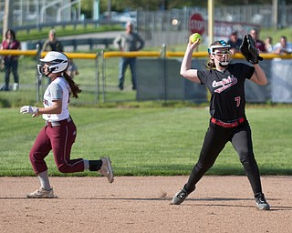 Canfield's Liz Ferraro throws the ball to first while Boardman's Nadia Rawhneh runs past her to get to third during their game on Wednesday. Boardman won 6-0. EMILY MATTHEWS | THE VINDICATOR