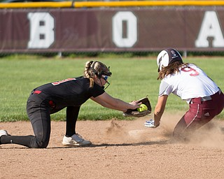 Boardman's Dana Haus gets past Canfield's Jackie Kinnick's tag to safely steal second during their game at Boardman on Wednesday. Boardman won 6-0. EMILY MATTHEWS | THE VINDICATOR