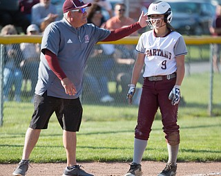 Boardman's head coach Fred Mootz pats Dana Haus on the helmet after she makes it to third during their game against Canfield on Wednesday. Boardman won 6-0. EMILY MATTHEWS | THE VINDICATOR