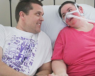 William D. Lewis The Vindicator  Christine Terlesky , who has ALS, whares a moment with her husband Brian in their Boardman home 4-4-19.