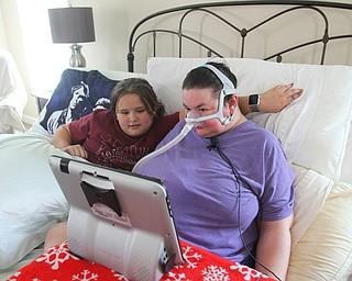 Christine Terlesky and her daughter Emma shop via computer.