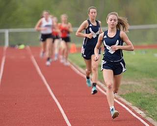 McDonald's Anna Guerra runs the Girls 3200 Meter Run with McDonald's Sophie Klase behind her at the Mahoning Valley Athletic Conference High School League Championship Meet at Western Reserve High School on Thursday. EMILY MATTHEWS   THE VINDICATOR