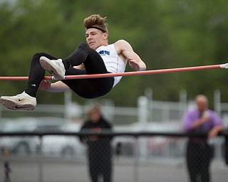 Jackson Milton's Ryan Staton attempts to clear the high jump at the Mahoning Valley Athletic Conference High School League Championship Meet at Western Reserve High School on Thursday. EMILY MATTHEWS   THE VINDICATOR