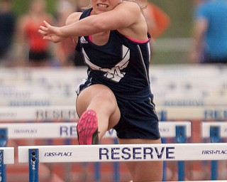 McDonald's Naomi Domitrovich finishes in the lead for the Girls 100 Meter Hurdles at the Mahoning Valley Athletic Conference High School League Championship Meet at Western Reserve High School on Thursday. EMILY MATTHEWS   THE VINDICATOR